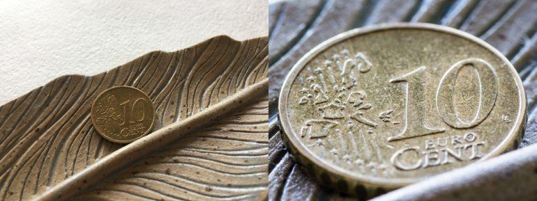 Kümme eurosenti savist taldrikul